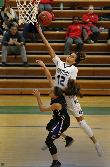 Foothill's Rae Burrell shoots a layup over Durango's Esmeralda Buenrostro during a high school basketball game at the Gator Winter Classic on Tuesday, Dec. 27, 2016, in Henderson. (Christian K. Le ...