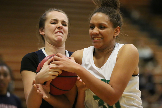 Coronado sophomore Tegan Varrati (43), left, and Green Valley junior Samar Miller (30), right, battle for the ball during a game at Green Valley High School in Henderson on Wednesday, Feb. 1, 2017 ...