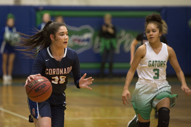 Coronado junior Haley Tyrell (35), left, takes the ball to the basket during a game at Green Valley High School in Henderson on Wednesday, Feb. 1, 2017.  Coronado Cougars defeated the Green Valley ...