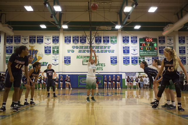 Green Valley sophomore Quii Harmon (11) makes a free-throw shot during a game at Green Valley High School in Henderson on Wednesday, Feb. 1, 2017.  Coronado Cougars defeated the Green Valley Gator ...