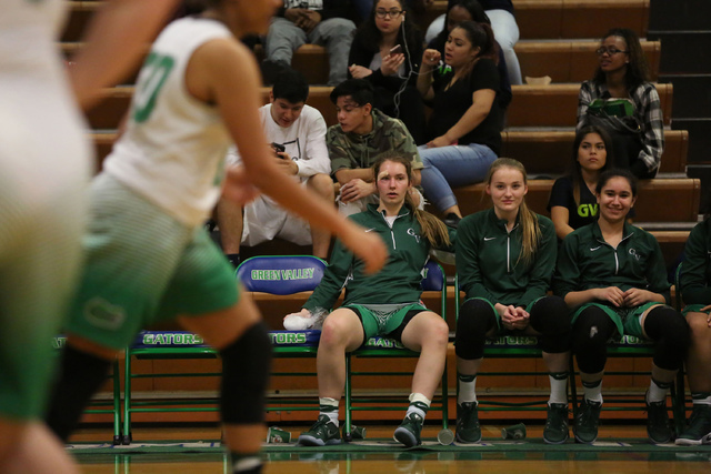 Green Valley Gators players watch their team from the bench during a game against Coronado Cougars at Green Valley High School in Henderson on Wednesday, Feb. 1, 2017. Coronado Cougars defeated th ...