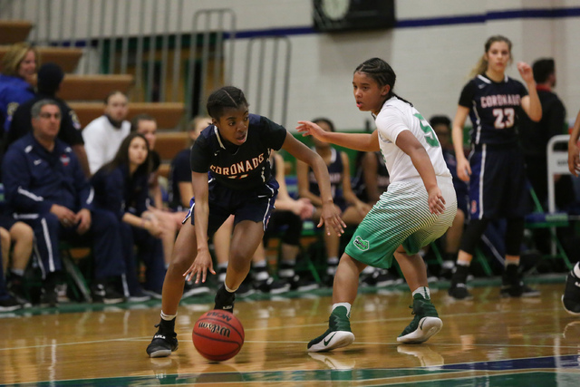 Coronado sophomore Tia Thornton (11), left, makes her way around  Green Valley sophomore Shelby Clark (5), right, with the ball during a game at Green Valley High School in Henderson on Wednesday, ...