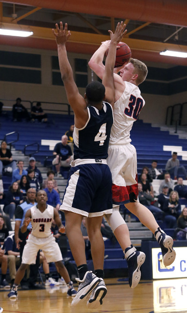 Coronado's Kennedy Koehler (30) shoots over Foothill's Mauricio Smith (4) during a high school basketball game on Tuesday, Feb. 7, 2017, in Henderson. (Christian K. Lee/Las Vegas Review-Journal) @ ...