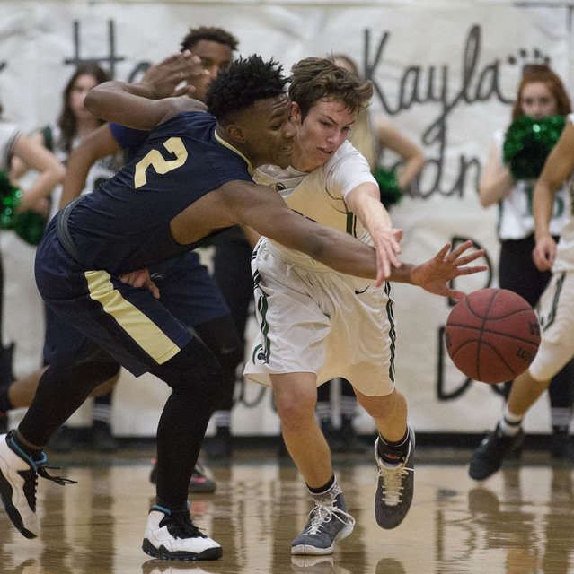 Palo Verde junior Mitchell Olsen, right, and Shadow Ridge senior James Fuller, left, battle for the ball at Palo Verde High School on Thursday, Feb. 9, 2017, in Las Vegas. (Bridget Bennett/Las Veg ...