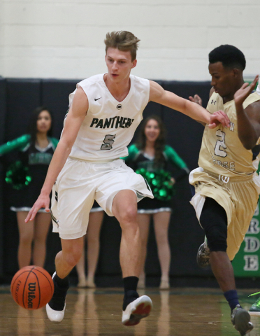 Palo Verde's Grant Dressler, left, drives past Shadow Ridge's Melvin Johnson on Tuesday. Dressler had 27 points and 10 rebounds in a 77-71 Palo Verde win. (Ronda Churchill/Las Vegas Review-Journal)