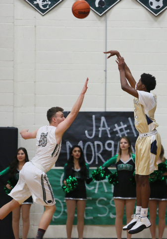 Shadow Ridge's Jerell Springer, right, shoots the ball over Palo Verde's Nick Cavaleri on Tuesday. Springer had 27 points and eight rebounds, but Palo Verde won, 77-71. (Ronda Churchill/Las Vegas  ...