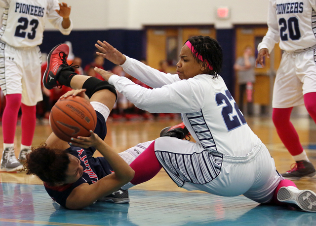Liberty's Aubre Fortner, left, and Canyon Springs' Skyler Franklin get tangled during Wednesday's game at Canyon Springs. Liberty won 58-39. (Ronda Churchill/Las Vegas Review-Journal)