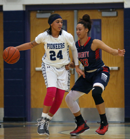 Canyon Springs' Daijhan Cooks, left, is guarded by Liberty's Aubre Fortner during Wednesday's game. Cooks had eight points, but Liberty won 58-39. (Ronda Churchill/Las Vegas Review-Journal)