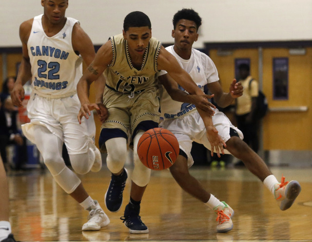 Canyon Spring's Jovon Coleman (22), from left, Cheyenne's D'Andre Houston (15) and Canyon Spring's Christopher Hawkins (2) chases after a loose ball during a boys basketball game on Friday, Jan. 1 ...