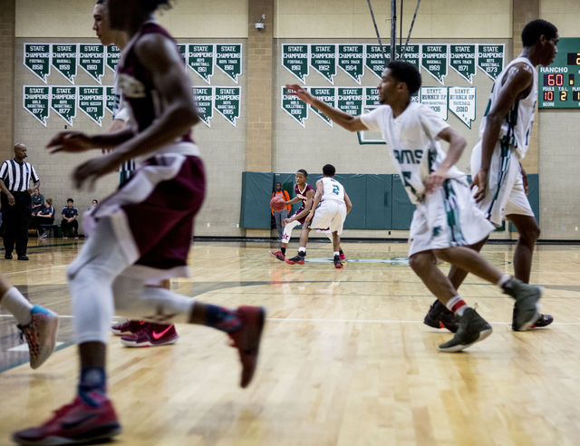 Agassi Prep Guard Najeeb Muhammad, (1), shoots the ball against the Rancho Rams at Rancho High School in Las Vegas, Monday, Jan. 16, 2017. (Elizabeth Brumley/Las Vegas Review-Journal) @EliPagePhoto