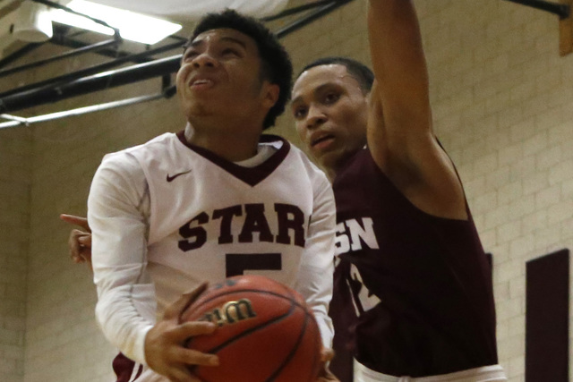 Agassi's Allen Merritt (50) shoots a layup over Innovations International's Justin Evans (12) during a boys basketball game on Wednesday, Jan. 18, 2017, in Las Vegas. (Christian K. Lee/Las Vegas R ...