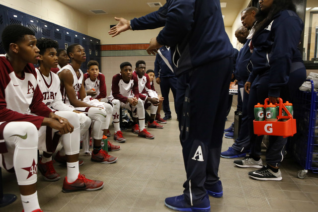 Agassi players listen to their coach during halftime at a boys basketball game on Wednesday, Jan. 18, 2017, in Las Vegas. (Christian K. Lee/Las Vegas Review-Journal) @chrisklee_jpeg