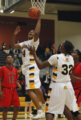 Clark's Diontae Jones (24) grabs a rebound in front of Las Vegas' Devon Colley (12) and Tyshon Raybon (14) earlier this season. Jones averaged 13.9 points, 9.1 rebounds and 2.0 and was named the D ...
