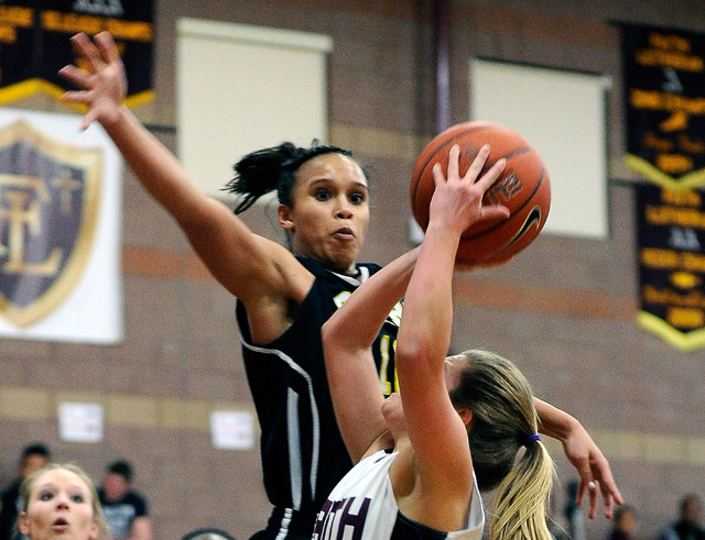 Clark's Bobbi Floyd lines up to block a shot by Faith Lutheran's Dani Tharaldson earlier this season. Floyd averaged 19.8 points and 14.7 rebounds and was named the Division I-A Southern Region MV ...
