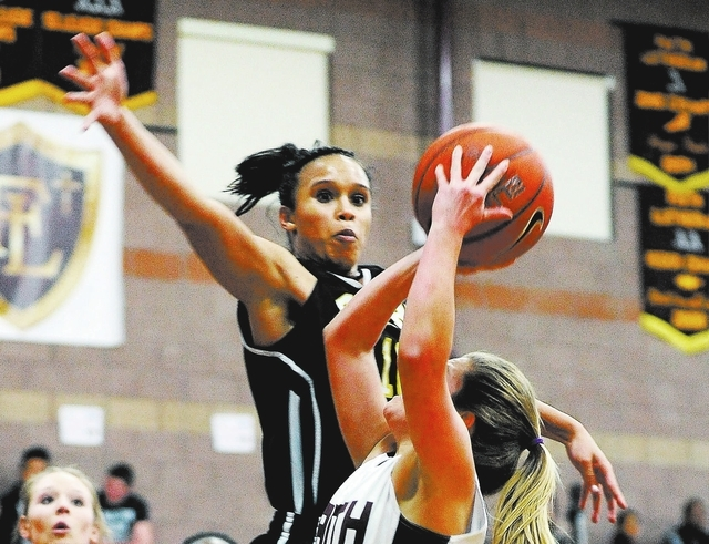Clark's Bobbi Floyd lines up to block a shot by Faith Lutheran's Dani Tharaldson during a girls high school basketball game at Faith Lutheran High School on Thursday, Jan. 23, 2014. Clark won 41-4 ...