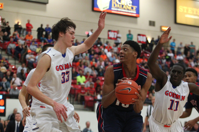 Findlay Prep's Justin Jackson (15) is surrounded by Bishop Gorman's Stephen Zimmerman (33) and Obim Okeke (11) last season. Jackson, one of the nation's top juniors, orally committed to play at UN ...