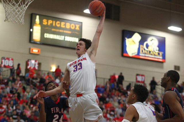 Bishop Gorman's Stephen Zimmerman (33) seen going for a dunk against Findlay Prep, said he won't rush his college decision. (Chase Stevens/Las Vegas Review-Journal)