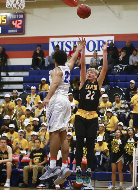 Clark guard Trey Woodbury (22) shoots over Bishop Gorman forward Ryan Kiley (23) during a basketball game at Bishop Gorman High School in Las Vegas on Tuesday, Jan. 31, 2017. Clark won 68-62. (Cha ...