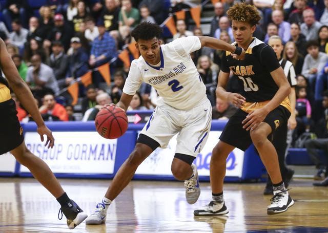 Bishop Gorman Jamal Bey (2) drives to the basket past Clark forward Jalen Hill (20) during a basketball game at Bishop Gorman High School in Las Vegas on Tuesday, Jan. 31, 2017. Clark won 68-62. ( ...