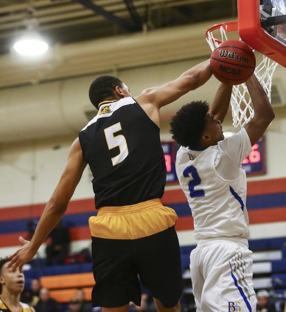Clark forward Deshawn Wilson (5) blocks a shot from Bishop Gorman Jamal Bey (2) during a basketball game at Bishop Gorman High School in Las Vegas on Tuesday, Jan. 31, 2017. Clark won 68-62. (Chas ...