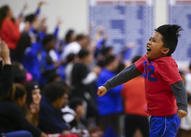 Bishop Gorman supporter Derek Octaviano, 10, cheers after the basketball team scored against Clark during a game at Bishop Gorman High School in Las Vegas on Tuesday, Jan. 31, 2017. Clark won 68-6 ...