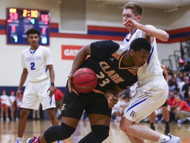 Clark forward Antwon Jackson (23) drives against Bishop Gorman guard Noah Taitz (20) during a basketball game at Bishop Gorman High School in Las Vegas on Tuesday, Jan. 31, 2017. Clark won 68-62.  ...