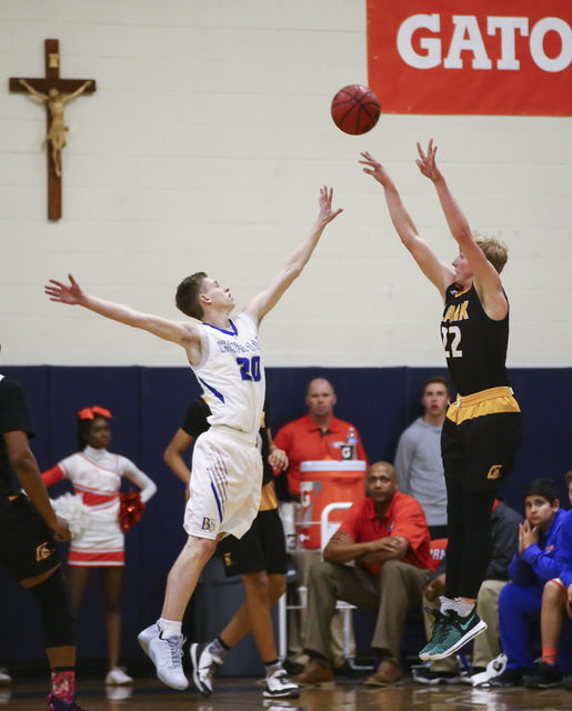 Clark guard Trey Woodbury (22) attempts a three-pointer as Bishop Gorman guard Noah Taitz (20) defends during a basketball game at Bishop Gorman High School in Las Vegas on Tuesday, Jan. 31, 2017. ...