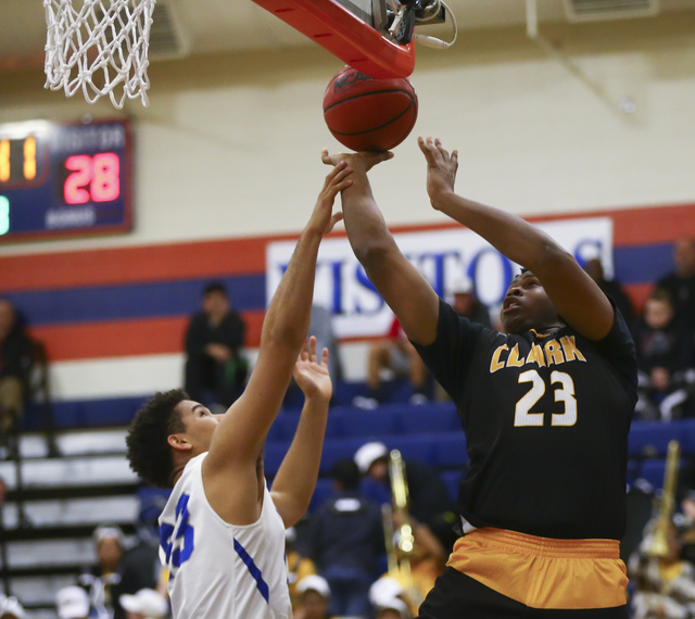Clark forward Antwon Jackson (23) goes up for a shot as Bishop Gorman forward Ryan Kiley (23) defends during a basketball game at Bishop Gorman High School in Las Vegas on Tuesday, Jan. 31, 2017.  ...