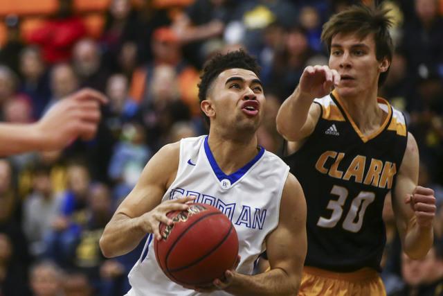 Bishop Gorman guard Jarrett Jordan (0) drives to the basket as Clark forward Adam Forbes (30) defends during a basketball game at Bishop Gorman High School in Las Vegas on Tuesday, Jan. 31, 2017.  ...