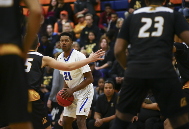 Bishop Gorman guard Christian Popoola (21) looks for an open pass during a basketball game against Clark at Bishop Gorman High School in Las Vegas on Tuesday, Jan. 31, 2017. Clark won 68-62. (Chas ...