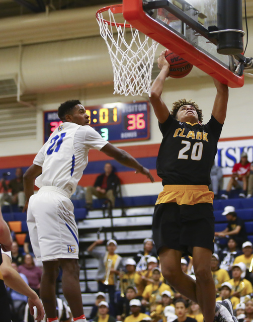 Clark forward Jalen Hill (20) goes up to the basket against Bishop Gorman guard Christian Popoola (21) during a basketball game at Bishop Gorman High School in Las Vegas on Tuesday, Jan. 31, 2017. ...