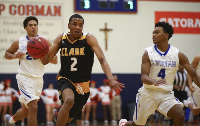 Clark guard Sedrick Hammond (2) drives past Bishop Gorman guard D.J. Howe (4) during a basketball game at Bishop Gorman High School in Las Vegas on Tuesday, Jan. 31, 2017. Clark won 68-62. (Chase  ...
