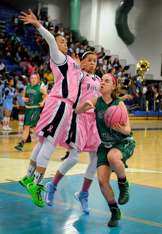 Green Valley's Ellee Barton is double teamed by Canyon Springs' Daijhan Cooks, left and Cherise Beynon on Monday. Canyon Springs won, 68-60. (David Becker/Las Vegas Review-Journal)
