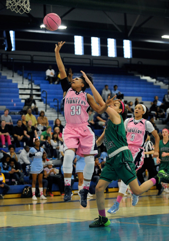 Canyon Springs' LaKiya Yarber shoots as Green Valley's Cassandra Palor defends on Monday. (David Becker/Las Vegas Review-Journal)