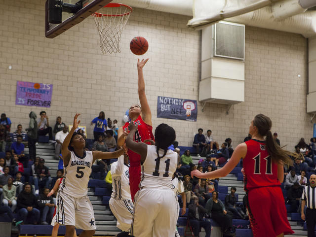 Lincoln County center Kristal Jackson (24) shoots the ball during a game at Andre Agassi College Preparatory Academy  in Las Vegas on Friday, Feb. 10, 2017. (Miranda Alam/Las Vegas Review-Journal) ...
