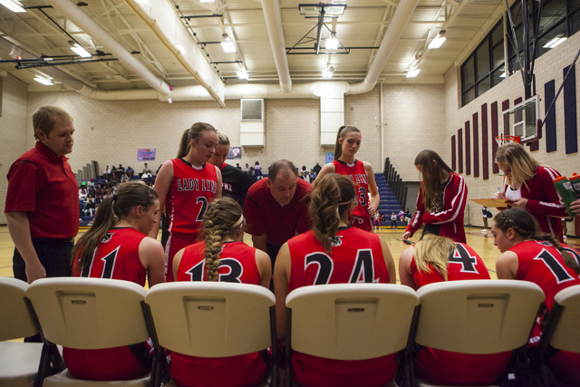 The Lincoln County girls basketball gather during a timeout at Andre Agassi College Preparatory Academy  in Las Vegas on Friday, Feb. 10, 2017. (Miranda Alam/Las Vegas Review-Journal) @miranda_alam