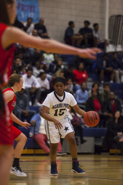 Agassi Prep guard Denise Parker (15) drives the ball during a game against Lincoln County at Andre Agassi College Preparatory Academy  in Las Vegas on Friday, Feb. 10, 2017. (Miranda Alam/Las Vega ...