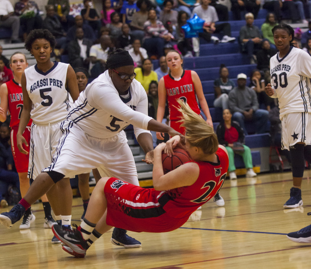 Lincoln County forward Emily Rowe (22) is tripped up by an Agassi player at Andre Agassi College Preparatory Academy  in Las Vegas on Friday, Feb. 10, 2017. (Miranda Alam/Las Vegas Review-Journal) ...