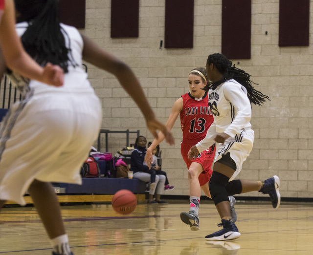 Lincoln County guard Kailey Kelley (13) drives the ball during a game against Lincoln County at Andre Agassi College Preparatory Academy  in Las Vegas on Friday, Feb. 10, 2017. (Miranda Alam/Las V ...