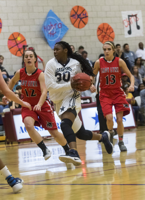 Agassi Prep guard Sharmayne Finley (30) drives the ball during a game against Lincoln County at Andre Agassi College Preparatory Academy  in Las Vegas on Friday, Feb. 10, 2017. (Miranda Alam/Las V ...