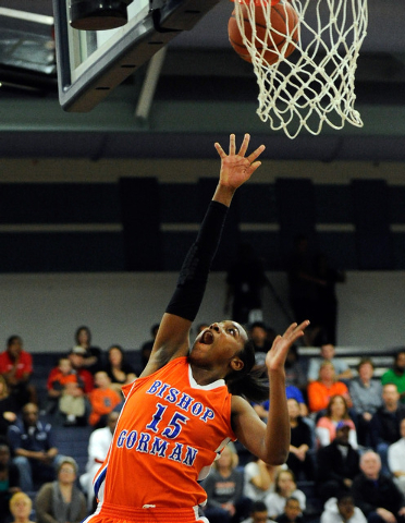 Bishop Gorman's Maddison Washington goes in for a layup against Centennial on Thursday. Washington had 10 points and 13 rebounds as Bishop Gorman won 65-50. (David Becker/Las Vegas Review-Journal)