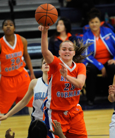 Bishop Gorman's Megan Jacobs (23) passes the ball against Centennial on Thursday. Jacobs had eight points and seven rebounds as Bishop Gorman won, 65-50. (David Becker/Las Vegas Review-Journal)