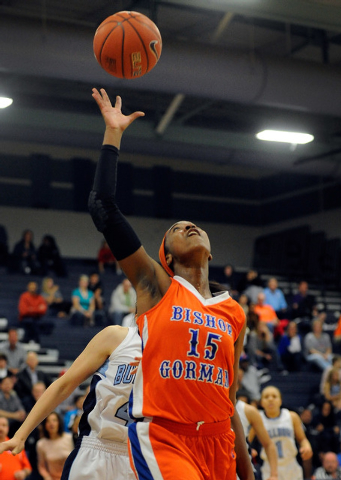 Bishop Gorman's Maddison Washington reaches for the ball on Thursday. Washington had 10 points and 13 rebounds as Bishop Gorman won, 65-50. (David Becker/Las Vegas Review-Journal)