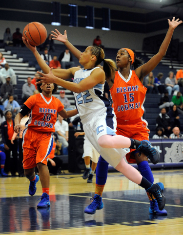 Centennial's Teirra Hicks (22) shoots as Bishop Gorman's Maddison Washington (15) defends on Thursday. Hicks had 20 points and 12 rebounds, but Bishop Gorman won, 65-50. (David Becker/Las Vegas Re ...