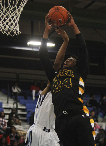 Clark's Diontae Jones (24) grabs a rebound over Canyon Springs' Maurice Hunter (12) earlier this season. Jones averaged 13.9 points, 9.1 rebounds and 2.0 and was named the Division I-A Southern Re ...