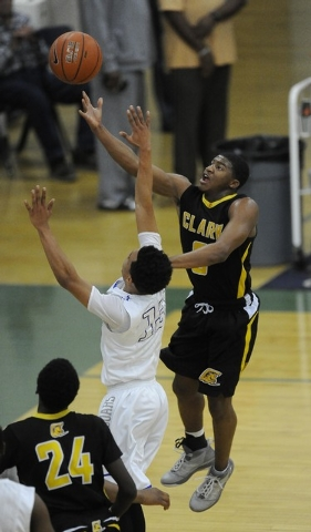 Clark guard Colby Jackson goes up for a layup against Desert Pines guard Coby Myles (13) in the second quarter of the Division I-A Southern Region championship game on Saturday. Jackson had 19 poi ...