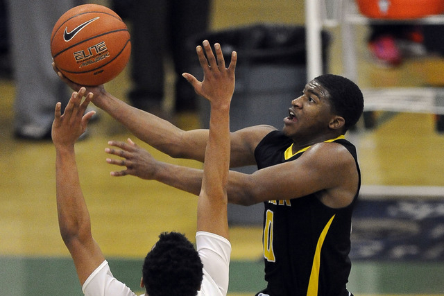 Clark guard Colby Jackson goes up for a layup against Desert Pines guard Coby Myles (13) during the Division I-A Southern Region title game on Saturday at Spring Valley. Jackson had 19 points, fiv ...