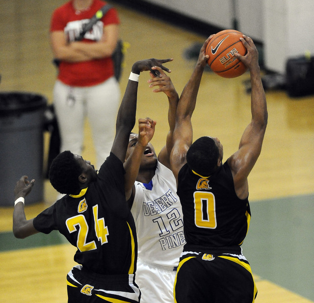 Clark guard Colby Jackson grabs a rebound as Desert Pines forward Jalen Graves (12) and Clark forward Wilson Samuel (24) grab for the loose ball on Saturday. Jackson had 19 points, five rebounds,  ...