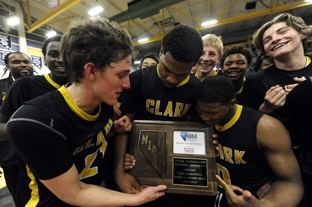 Clark Chargers players celebrate their 56-51 victory over Desert Pines in the Division I-A Southern Region title game on Saturday. (Josh Holmberg/Las Vegas Review-Journal)