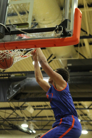 Bishop Gorman's Chase Jeter (4) dunks the ball during a scrimmage against Valley on Tuesday. (Erik Verduzco/Las Vegas Review-Journal)